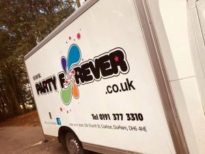Photograph of Party forever van with Logo