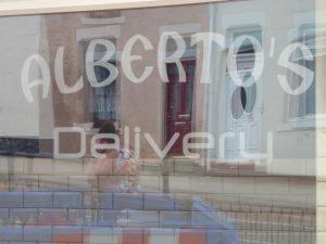 Photograph of Alberto's shop window