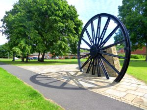 Photograph of the Pit Wheel on the village green with shadow about 2014