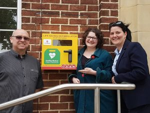 Photograph of councillors and Nicola Dodsworth outside Village Hall defib