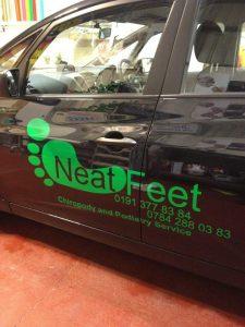 Photograph of Neet Feet car with logo