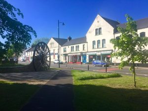 Photograph of Coxhoe Village Green South. The photo has Church Street in the backgound and a brilliant blue sky