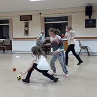 Photograph of Young People playing bowls