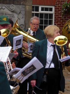 Photograph of musicians preparing to play