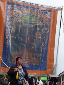 Photograph of a woman marching the banner