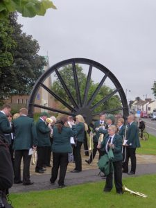 Photograph of or brass band at pit wheel