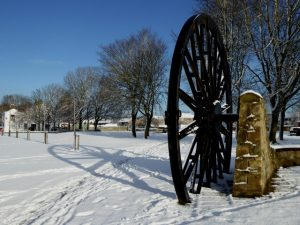 Photograph of the Pit wheel on the Village Green in wintertime.