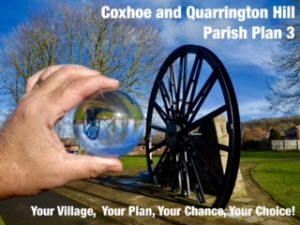 Photo of a Parish Plan poster with the pit wheeel saying Coxhoe and Quatrrington Hill Parish Plan 3, Your Village, Your Plan, Your Chance, Your choice