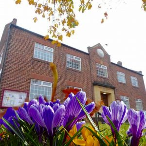 Village Hall with crocus superimposed in the forground