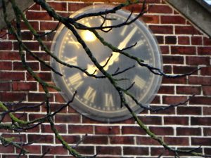 The millenium clock at village hall at 8 in the morning