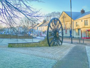 Photograph of pit wheel on a frosty day in HDR in 2020. It contains a very blue tint