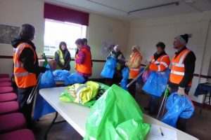 Photograph of litter picker volunteers at village hall getting trained for 2020