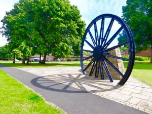 Photograph of pit wheel in full sun with shadow which was completed and opened in 2014