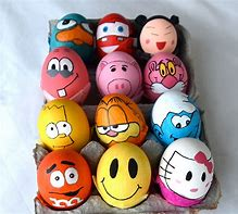 decorated easter eggs. there is a dozen all with brightly coloured faces