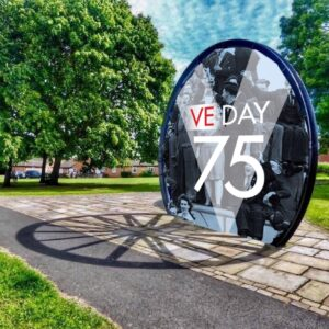 Coxhoe Pitwheel with a Ve Day 75 poster within the wheeel