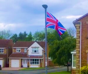 Flag flying in streeet in Coxhoe
