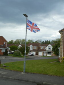 A union flag flying in street