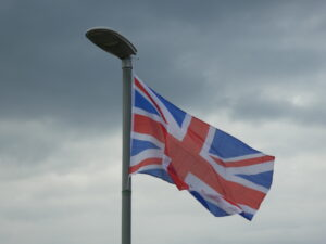 A f flag flying in low light