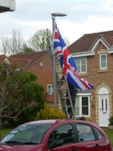A man putting up flag