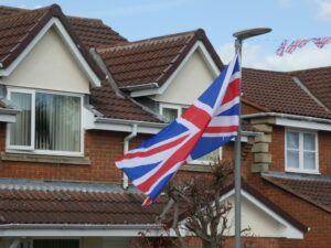 Large flag flying in wind from lampost