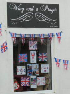 The shop called a wing and a prayer with flags and posters on VE day