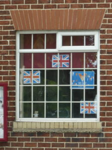 Four lags in Parish Council Office window