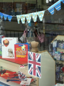 A flag and bunting in shop window