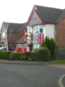 different VE Day flags on house