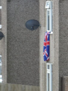 A largef flag flying from window