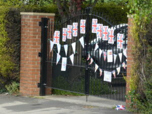 A large gate with flags and bunting