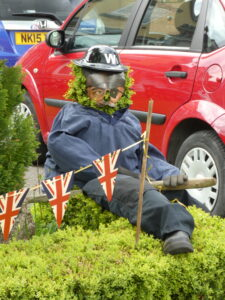 Warden figure with flags