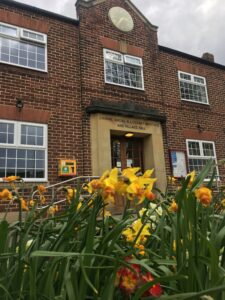 Coxhoe Village Hall with daffodils in front
